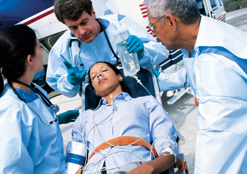 Emergency professionals and a patient